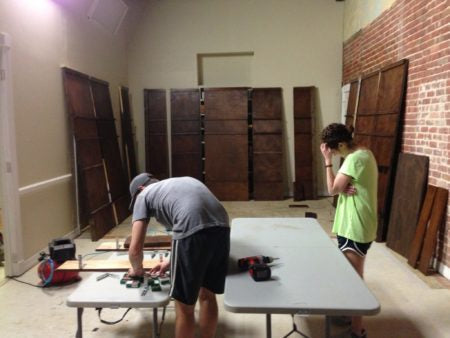 Neil and Dani helping build the walls for our booth at the 2013 National Stationery Show!