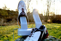 Shoe dryer in nature with golf shoes