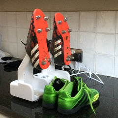 Shoe dryer in use with football shoes