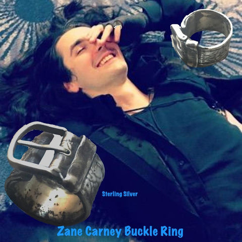"Did someone say, ""Buckle Up""?:) Substantial piece of pure vintage rock and roll--as seen on Zane Carney, John Mayer's lead guitarist, in this video from Letterman. Opulent,finely detailed band of timeless whimsy in Oxidized Sterling Silver Buckle Ring makes a statement alone or as part of a collection of fables..."