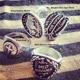 Four of my best Sterling Silver Rings and the most whimsical silver jewerly on the planet. Faux Buffalo Ring, Bargain Box Cigar Band Ring, Mild Havana Cigar Band Ring, Cross Adjustable Ring. All from Fablesintheair by Marti Heil. Hand made in the USA. Hand signed by the artsit/designer.
