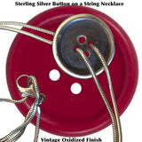 "Fablesintheair.com Sterling Silver Button on a String Necklace-based on the childhood home made toy with the same name.Sterling Silver Button on a Sterling Silver ""String' Necklace  Button 1"" diameter.  approximately.16"" chain. Made in the USA. Hand Signed."