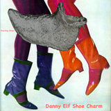 "On a background of 1960s MOD red and purple patent boots and tights.This textured Elf Slipper Shoe is enough to make your toes curl! Straight from ""I Dream of Jeannie"", (and The North Pole!) this whimsical large charm has beautiful lines and nearly resembles the magic lamp, itself! Even if the shoe doesn't fit...you can still wear it! Equally fun as a single charm on a bracelet as it is around your neck! Sterling silver textured elf shoe 3D charm with turned up toe...a truly magical charm and comes with a b"