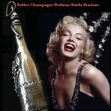 "Marilyn Monroe with Fablesintheair.com Champagne Perfume Bottle Necklace.When this cork pops...out wafts the smell of your favorite perfume, or aromatic oil... Fables Champagne... any imaginable scent..in an elegant sterling silver magnum. Fill with your favorite scent or oil. Puts you in the celebratory mood.  3-2/16"" x 1-1/2"" Approximately.  Sterling Silver Fables Champagne Perfume Bottle Charm. Comes on a sterling silver chain."