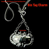 "Meant to adorn a neck of a different kind, this Gin Tag adapts beautifully, and why NOT? With its beautiful 2"" of on of my most favorite chains attached to the perfect bail, which opens and snaps over beads or pearls easily or slips through the most rugged chain. Engraved and ornate and available in either shiny or my vintage oxidized finish. Even teetotalers like this!  (Chains sold separately.)  1-3/4"" x 1"" x 2"" approximately.  Sterling Silver Gin Tag  Charm. Comes with black leather cord. Made in the USA"