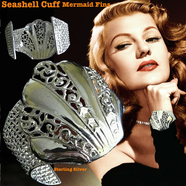 Fablesintheair's Sterling Silver Seashell Cuff with Mesh Mermaid Fins surrounding a beautiful openwork clamshell is a timeless piece of jewelry. Made in the USA. Hand signed by designer Marti Heil.