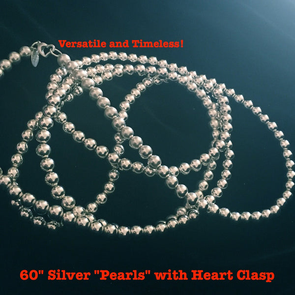 "These extra long silver ""pearls"" with a heart clasp are a fables ""classic"" and staple. Wear them wrapped 4 times as a choker, long and knotted, 3 times with one row resting inside the next, as a bracelet, folded in half and connected by one of our ""charming"" necklace shorteners or think up new ways on your own! And to polish, go to your hardware store and pick up a box of ""Twinkle"" Silver Polish and you will thank me! 60 inches 7mm sterling ""pearls"". By the way, these 60"" Sterling Silver ""Pearls"" are gender"