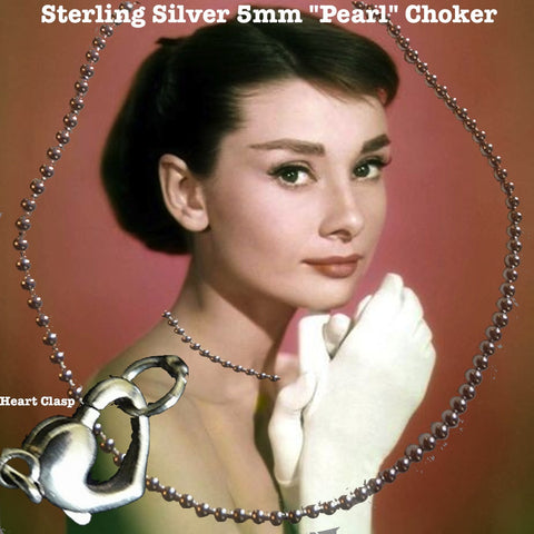 "Very ""Twilight"", very edgy, very femme fatale, this delicate choker of 5mm Sterling Silver ""Pearls""goes with everything and anything--even layered with other jewelry to give an opulent richness. The Sterling Silver Heart Lobster Fastener is equally beautiful if it slips to the front and creates a whole new look when adorned with one of our charms or necklace shorteners.  Made in the USA."