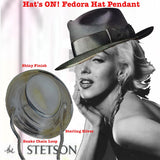 "This vintage fedora has panache with a touch of the snake--chain, that is! I've always thought there is something very special about ultra feminine women wearing menswear. Fedoras and red lipstick! So I pretended that the 50's were forward enough thinking to dare to do a Marilyn Monroe Stetson ad. I personally think sales would have gone through the roof, had they dared!  We had Greta Garbo create her own modified Fedora, the ""Garbo"", we saw Ingrid Bergman in ""Casablanca"", and they, most definitely had a ha"