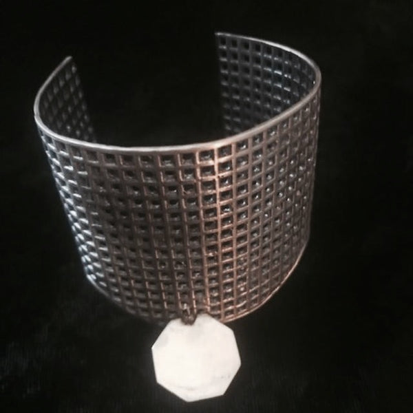 Sterling Silver Handmade STOP Pollution Grid Cuff. Each one, is a one of a kind, because we leave random holes plugged to make each one unique! Gender Neutral. Made with love in America. Hand signed behind the Stop Sign.