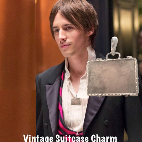 Sterling Silver Vintage Suitcase Charm is a hinged suitcase in which you can tuck an affirmation or scented cotton ball. Shown here on Reeve Carney.