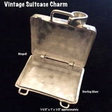 Sterling Silver Vintage Suitcase Charm is a hinged suitcase in which you can tuck an affirmation or scented cotton ball.