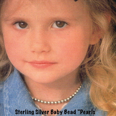 "Start her out with style! Fables Sterling Silver Baby Beads, her own ""Silver Pearls"" with dear heart lobster signature clasp. When she outgrows them, I will gift you a sterling silver extension chain. 12"" including heart clasp-approximate. These are also available in larger sizes...email me for quotes."