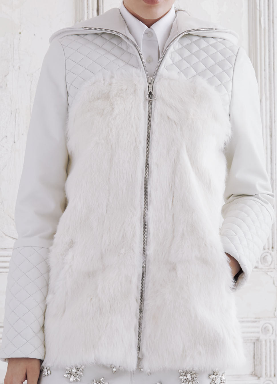 Quilted lamb leather and fur hoodie.