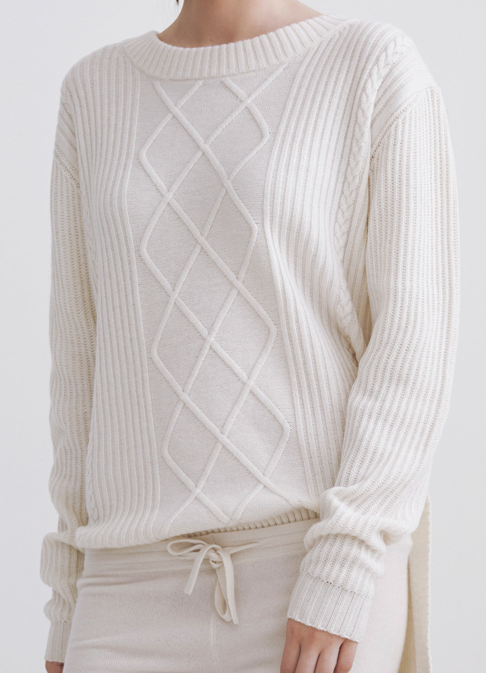 Cable hi-lo sweater