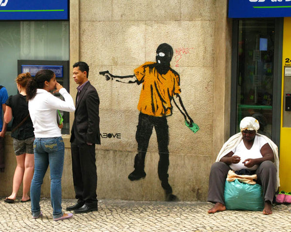 ABOVE street Art piece - Rich to poor in Lisbon
