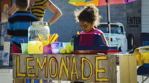 kids selling lemonade for business