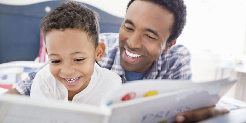 father reading to a son