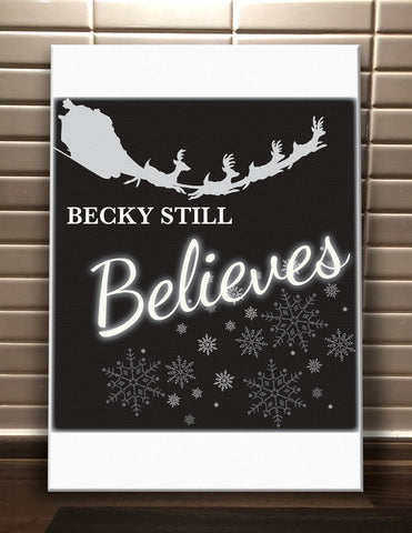 CC05 - Personalised Christmas Name inserted Still Believes Canvas Print.  Available in Black and Red.