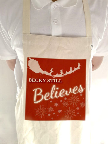 CC05 - Personalised Christmas Name inserted Still Believes Canvas Apron in Black or Red