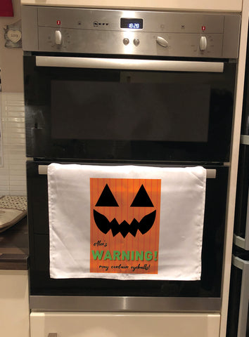 Pumpkin Themed Halloween Warning May Contain Eyeballs Personalised Tea Towel