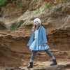 Everyone loves our woollen coats which are made from a selection of beautiful coloured wools and tailor made.  This coat is unisex so it is passed down to be treasured by the younger sisters or brothers.   Our loose fitting coat drapes around your child like a favourite blanket. Smart and warm it is a beautiful fit that you can wear open or buttoned up for a different look.