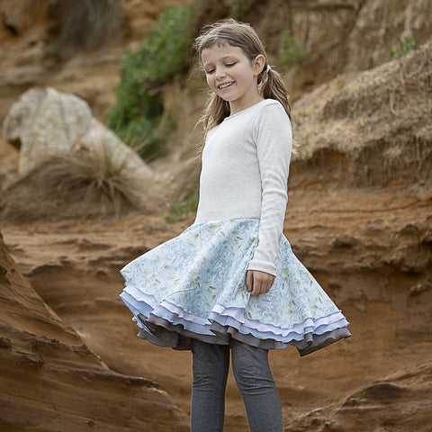 Our signature 'twirling dress'. We have been manufacturing our tutu's for 17 years for Summer and Winter.  Very comfortable for crawling or walking with the 1x1 cotton rib in cream marle fitted bodice.  With 4 full circle skirts that twirl. This style can easily be worn from 8 months old! (size 1-2)  Our Trudie tootoo dresses are easy to wear every day. And like all of our dresses easy to care for.
