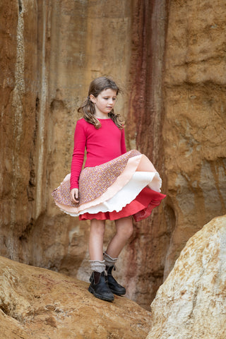 Our signature 'twirling dress'. We have been manufacturing our tutu's for 17 years for Summer and Winter.  Very comfortable for crawling or walking with the 1x1 cotton rib in red fitted bodice.  With 4 full circle skirts that twirl. This style can easily be worn from 8 months old! (size 1-2)  Our Trudie tootoo dresses are easy to wear every day. And like all of our dresses easy to care for.