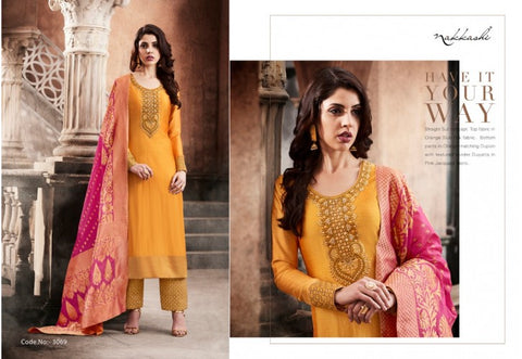 Yellow silk straght suit having embroidered patch paired with matching orange dupion textured bottom and a pink jacquard dupatta.