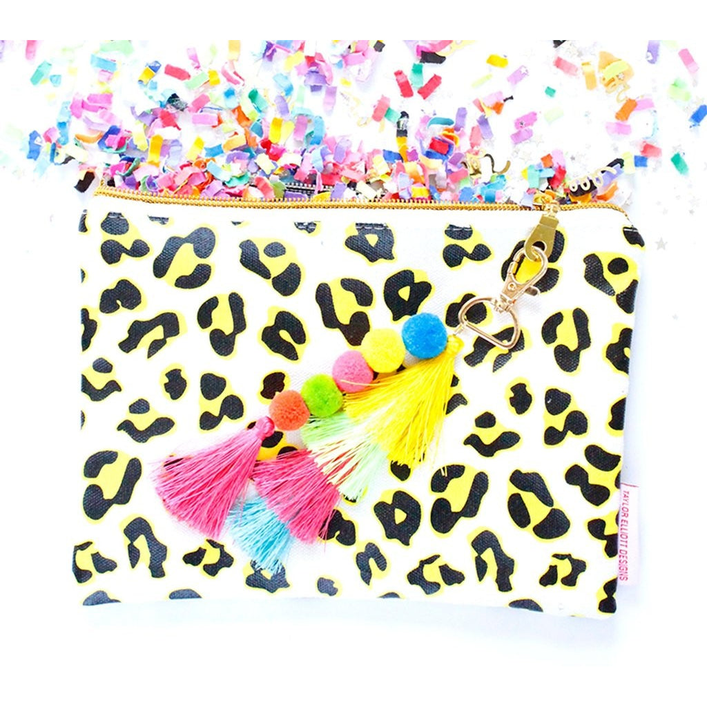 leopard print canvas pouch with pom pom and tassel clutch