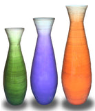 orange, purple, and green floor vases
