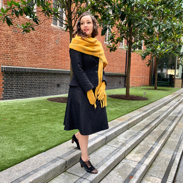 Womens suit wool black worn with mustard accessory colour pop