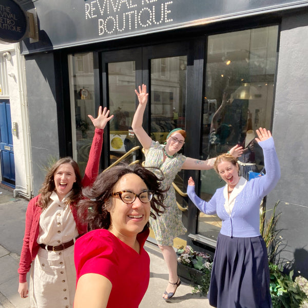 Four women currently comprise our team, they are jumping with excitement outside the shop