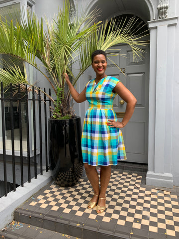 Woman in check dress