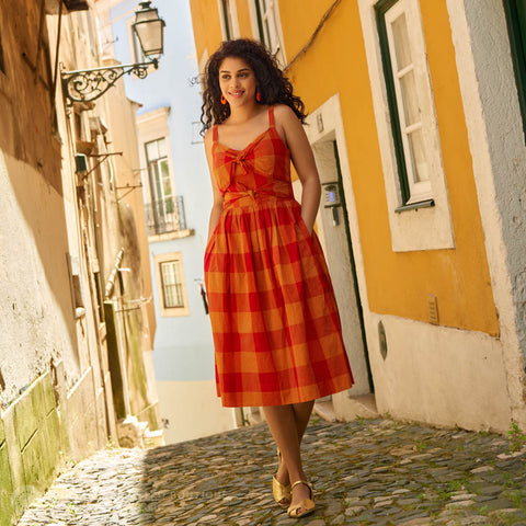 Woman in red check sundress
