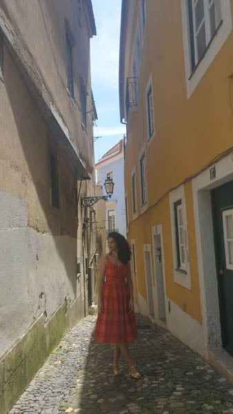 Woman in sundress in old town Lisbon