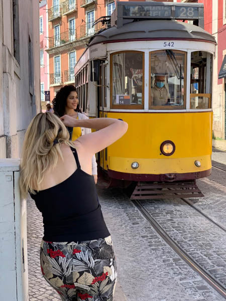 Photographer waits to get the shot at the right mment as tram comes in to view