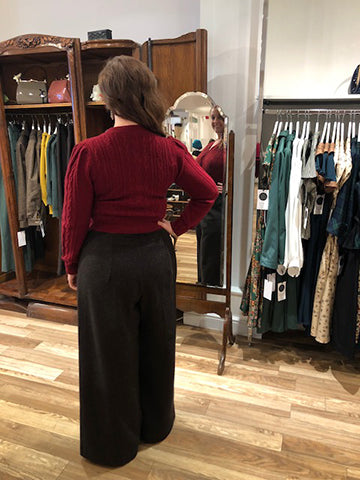 woman tries on trouser in mirror