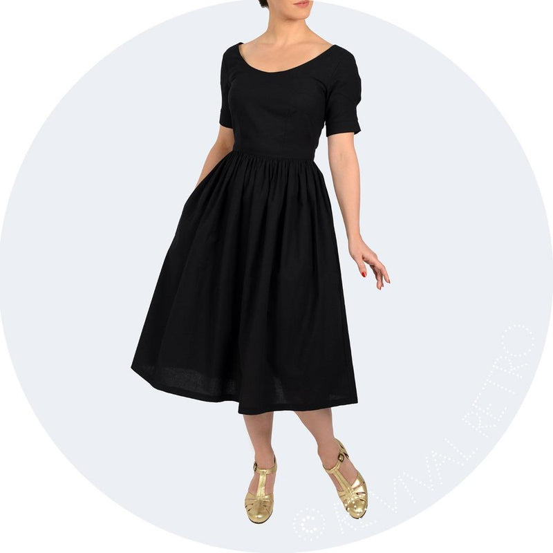 Black GOTS certified organic cotton 1950s style dress by Revival Retro