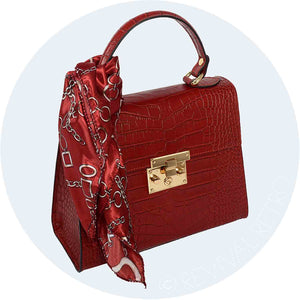 Vintage style leather handbag with printed scarf