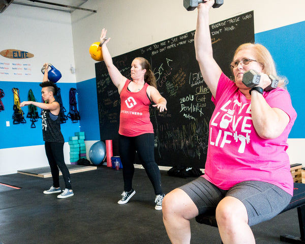 Ladies working with kettlebells