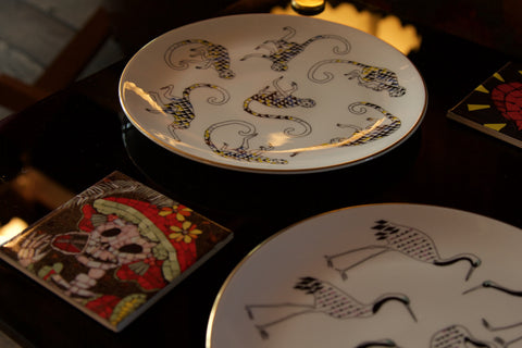 Plates from The Tropique Collection by Mira Santo and coaster tiles from Juan Is Dead