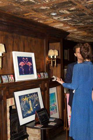 Rupert Newman and Aretha Campbell of Rook & Raven Gallery with Rupert's exclusive Flamingo print