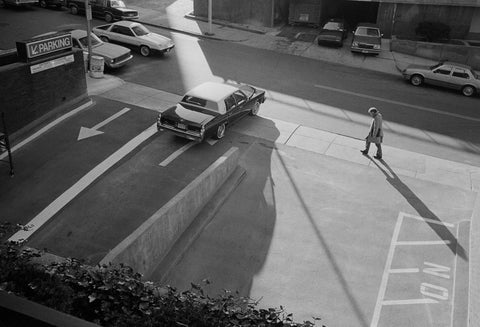 Man Walking Past Parking Lot, Michael Ormerod - CultureLabel