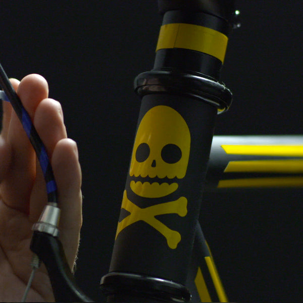 RydeSafe reflective stickers skull and bones on fixie bike head tube