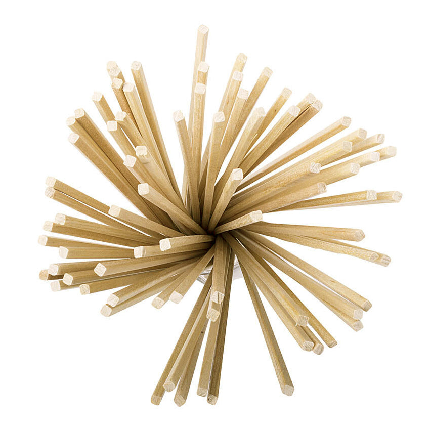 upper view of long candy floss wooden sticks with square edges