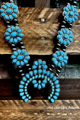 JUST THAT BEAUTIFUL TASSEL FLOWER IN TURQUOISE