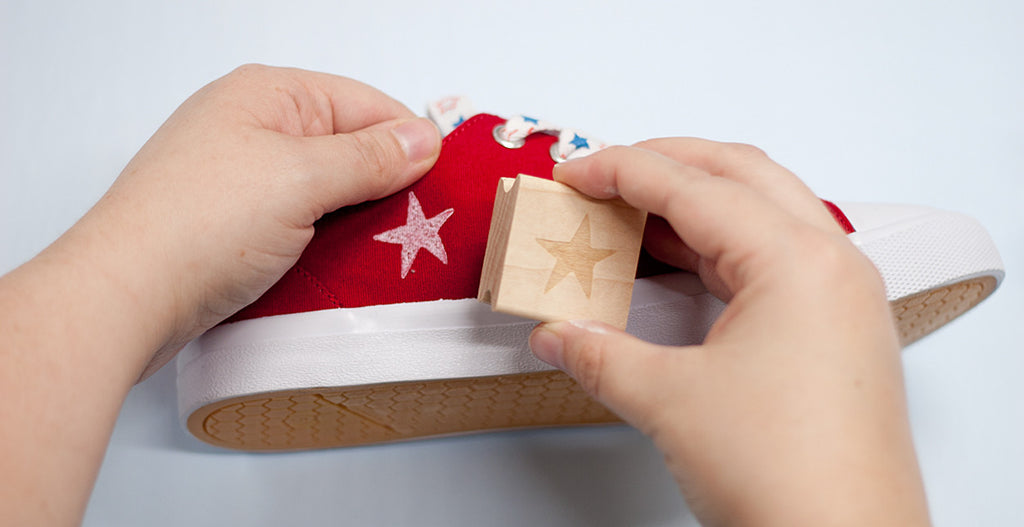 Stamp The Star Into Your New Ink Pad Getting An Even Coating Of White On While Holding Inside Shoe For Support Firmly And Evenly