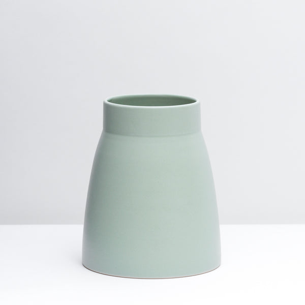 Canteen No. 1 Standard is a hand-thrown porcelain Vase in our Mint green glaze.  Use a utensil crock or style with flowers.  Handmade modern pottery. USA made ceramics and unique gifts. Mint pottery, green ceramics. USA Made pottery vase.