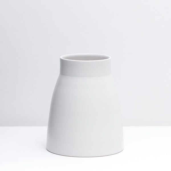 Canteen No. 1 Standard is a hand-thrown porcelain Vase in our Salt glaze, a white finish.  Use a utensil crock or style with flowers.  Handmade modern pottery. USA made ceramics and unique gifts. White pottery, white vase.